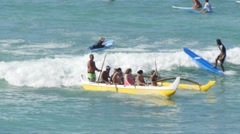 Surf boat kanoe in Waikiki beach Stock Footage