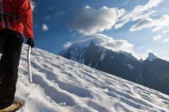 mountaineer alone glacier - stock photo