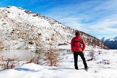 hiker winter mountain lake - stock photo