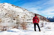 Stock Photo of hiker winter mountain lake