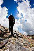 Stock Photo of man hiking up mountain