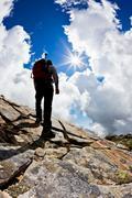man hiking up mountain - stock photo