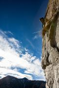 rock climber on a rock face. - stock photo