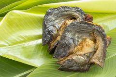 dry fish on  fresh banana leaf - stock photo