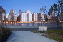 Night view of the New York City skyline from Roosevelt Island. - stock photo