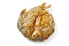 dried fish fried on white. - stock photo
