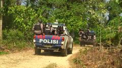 Police driving in jungle in Indonesia - stock footage