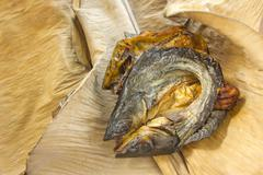 dry fish on dry banana leaf - stock photo