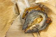 Dry fish on dry banana leaf Stock Photos