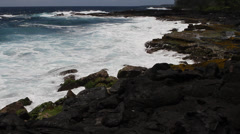 Ocean waves along the lava rock shore of the big island of Hawaii Stock Footage