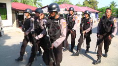 Armed policemen in Indonesia Stock Footage
