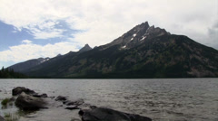 A beautiful lake in front of the Grand Tetons mountains. Stock Footage