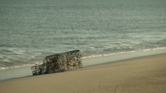 Lobster pot washed ashore Stock Footage