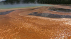 Steam rises from a geothermal lake at the Grand Prismatic Springs in Florida. Stock Footage