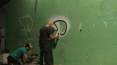Time lapse shot of graffiti being sprayed on a wall by taggers. Stock Footage