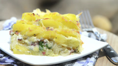 Portion of potato gratin (loopable) Stock Footage