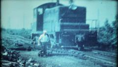 Railroad worker throws switches at the railyard - 813 - vintage film home movie Stock Footage