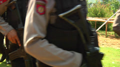 Indonesian police walk in jungle with guns Stock Footage