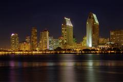 San diego skyline from the water at night Stock Photos