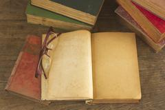 old opened book with blank pages - stock photo