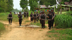 Indonesian Police in village Stock Footage