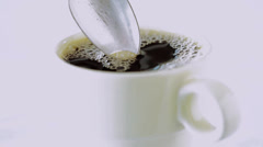 Coffee is stirred in a cup. - stock footage