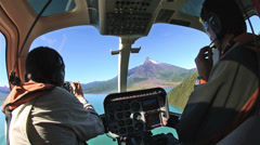 Photographer and pilot in a helicopter flying towards Corcovado Volcano in Stock Footage