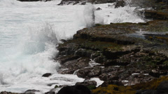 Ocean waves along the lava rock shore of the big island of Hawaii - stock footage