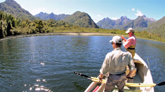 Bob Goodman and Jan Albertz on fly-fishing adventure on Ceasar Lake in Parque Stock Footage