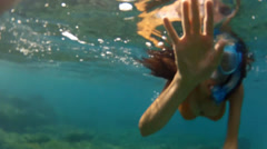 Woman snorkeling in the sea Stock Footage