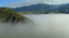 Flight over the Mountains. In the fog. Altai. Siberia Stock Footage