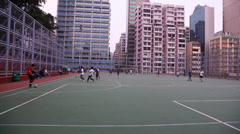 People play Soccer in the park in Hong Kong Stock Footage