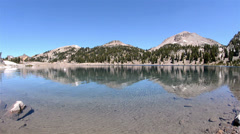 Clear blue water of Lake Helen below Eagle Peak in Lassen Volcanic National Stock Footage