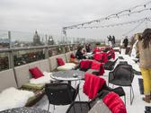 Stock Photo of in the snow on a rooftop restaurant