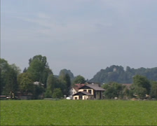Pan rural landscape near Salzburg + skyline fortress Hohensalzburg Castle Stock Footage