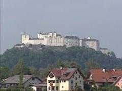 Salzburgerland countryside + zoom in skyline fortress Hohensalzburg Castle Stock Footage