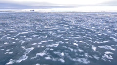 Tilt down bow point of view of an icebreaker ship plowing through sea ice in - stock footage