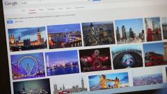 A young man does a Google image search for London Stock Footage