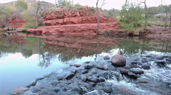 Panning of water flowing in Wet Creek near Beaver Creek Campground in Coconino Stock Footage