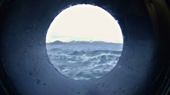 View through a ship's porthole while under way in the Galapagos Islands National Stock Footage