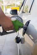 refilling car with fuel close up - stock photo