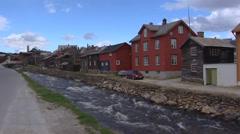 Roa River streaming through Roros village along Norwegian houses Stock Footage