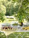 Stock Photo of a buffet table set up in a garden for al al fresco meal. salads