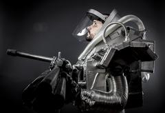 Spaceman, astronaut on a black background with huge weapon. Stock Photos