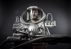 Science, astronaut on a black background with huge weapon. Stock Photos
