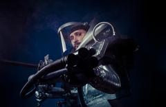 Galaxy, astronaut on a black background with huge weapon. Stock Photos