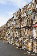 recycling facility with bundles of cardboard sorted and tied up for recycling - stock photo