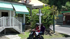 Guadeloupe Basse Terre district 014 a street crossing in a small village Stock Footage