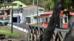 Guadeloupe Basse Terre district 033 colorful village and a bridge Stock Footage