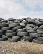 A stack of discarded rubber car tires, collected for recycling, or disposal. Stock Photos
